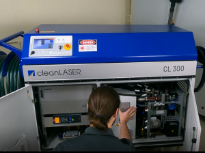 Laser Professional with hands in laser cleaning system performing maintenance